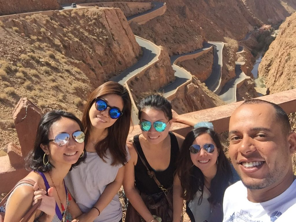 Guests enjoying a photo opportunity on a tour of Morocco