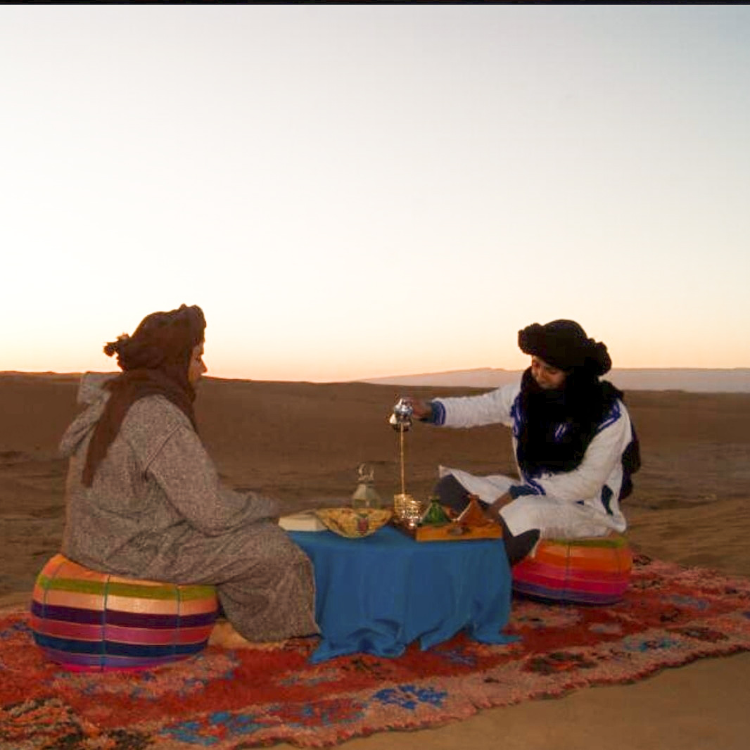 The drinking of Moroccan tea in the desert