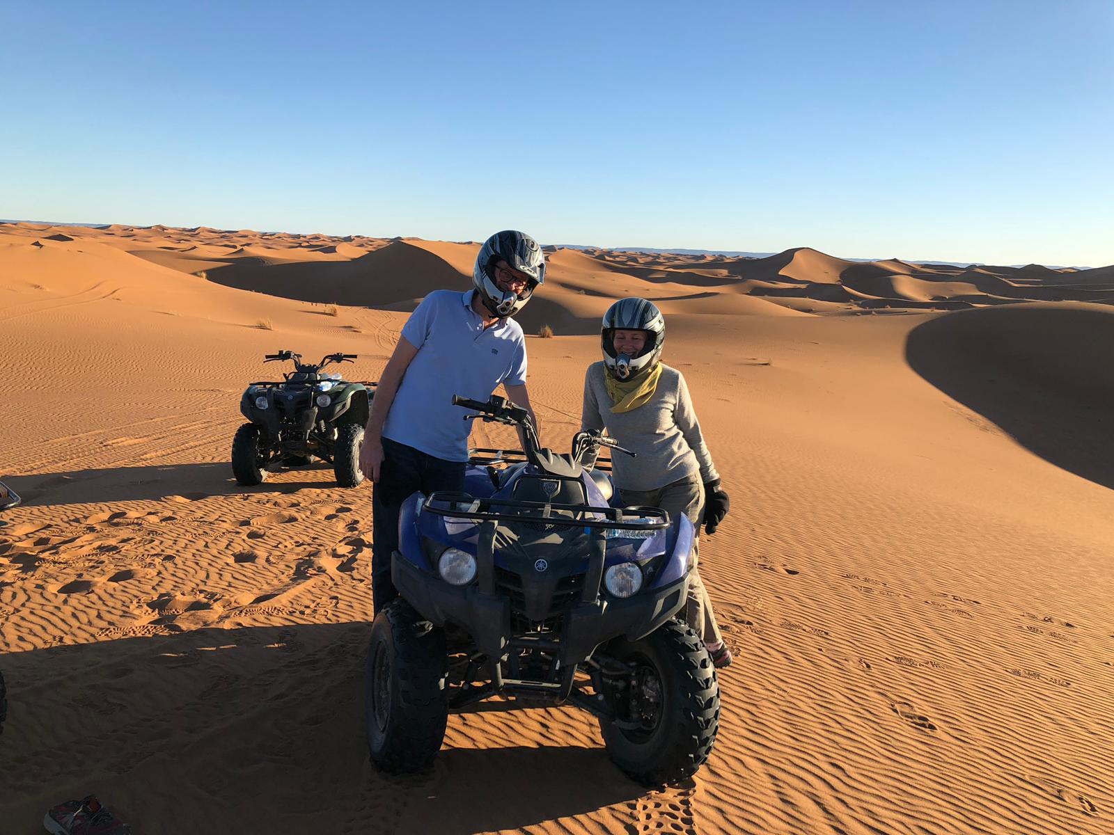 Two guests of Morocco Sunny Days enjoying quad biking in the desert
