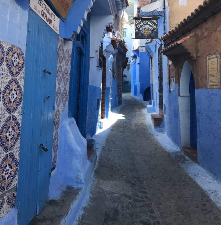 A narrow street in Essaouira showing the blue painted buildings